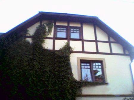 Облицовка фасада штукатуркой и камнем